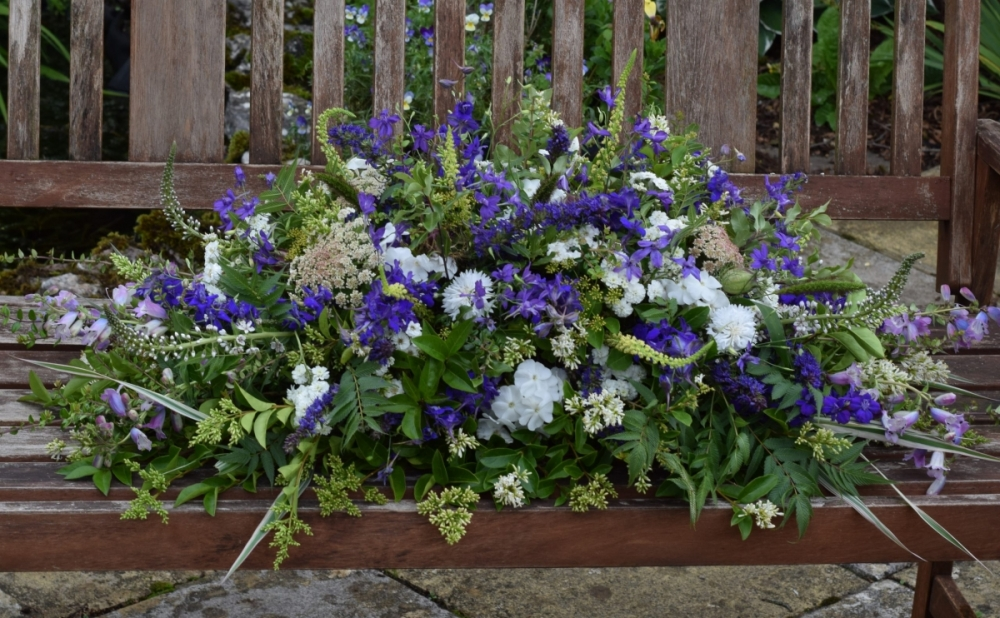 Natural Casket spray in blue and white